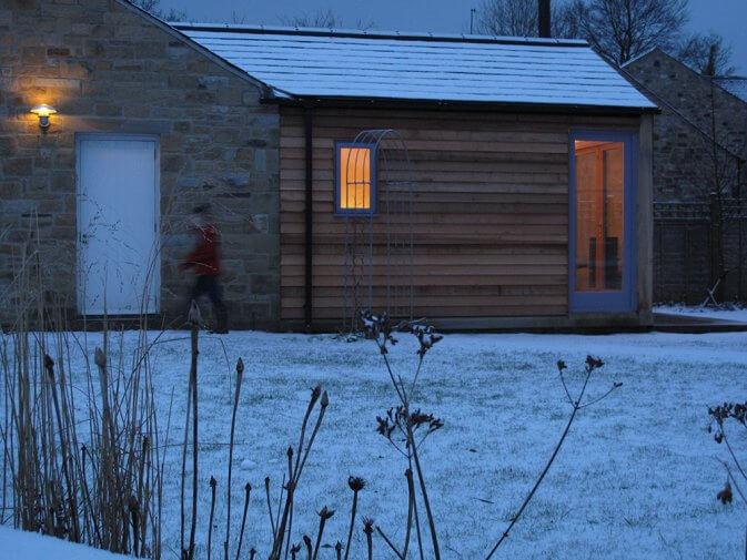 An environmentally- friendly green oak, cedar clad, timber framed studio office