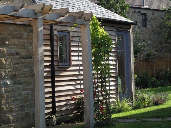 An environmentally- friendly green oak, cedar clad, timber framed studi